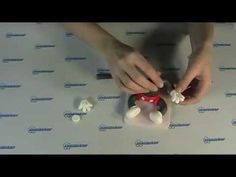 Mickey Mouse gumpaste video tutorial and a link for a photo tutorial on facebook