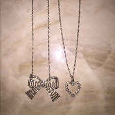 bundle of bow & heart necklace  both come included & they are in perfect condition ! Jewelry Necklaces