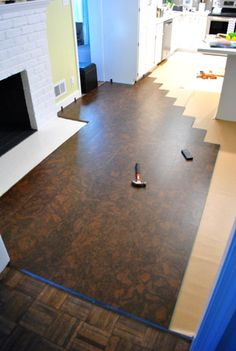Installing a floating floor (cork) over existing flooring, plus a tip for cutting door moulding without removing it or using special tools | Young House Love