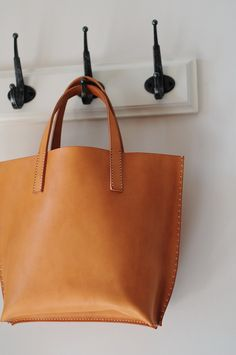 Hand Stitched Light Brown Leather Handbag. $110.00, via Etsy.