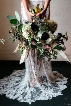 """too """"poofy"""" and full, however I LOVE the colors, the green/muted hydrangea, the metallic & gold painted ferns, the subtle dark purples, the sprig of pompous grass. I like the farm meets woods meets festive glam feel."""