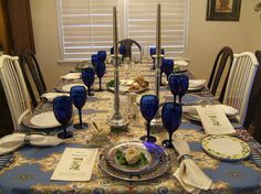 Beautiful Passover table setting. Love the blue wine glasses.