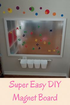 Using a sheet of galvanized steel and a simple pre-made wooden frame, it was easy to make a cheap DIY magnet board for my toddler to play with.