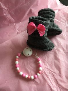 Handmade knitted boots and pacifier make a great holiday gift!