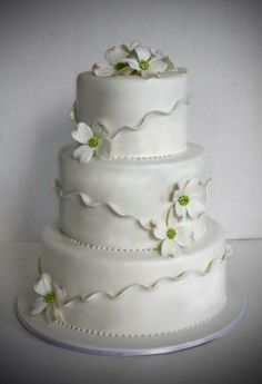 Delicate, Shimmering Ruffles & Dogwood Flowers~ Wedding Cake by http://www.veryuniquecakes.com