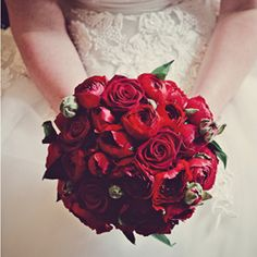 This stunning red rose bouquet is studded with ruffly ranunculus for a modern detail in this classic fifties wedding {images by Claire Penn}