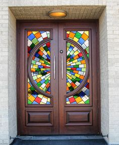 "DbyD-7092. This pair of Mahogany Custom Style ""H"" Doors are on St. Bede's Catholic Church in Montgomery, Alabama. These doors were custom designed, built, stained and finished and installed by Doors By Decora to replace the doors shown below on the right. They compliment the Stained Glass windows in this Contemporary Church. The picture on the lower left shows a closeup of the glass so you can see some of the different textures."