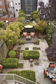 Modern Garden; low deck for chairs placed at far end to look onto back of home instead of neighbours;