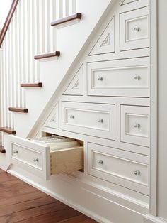 Organization tip: Have a cabinet maker or contractor help you utilize square footage i n your home with an organizational system beneath the stairs.