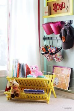 Turn a wooden drying rack into a bookshelf for a child's room or play room (via IHeart Organizing).