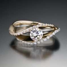 Covet Curvaceous and enchanting. A ring to treasure. Covet ring is pictured here with a .50 carat center stone and 42 pavé set VS G accent diamonds in a 14kt yellow and white gold setting.
