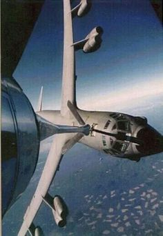 Refueling B52, while banking in a circle and will break off when the fueling is complete.