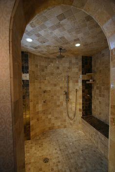 Love the architecture of this shower room and the warm and natural colors