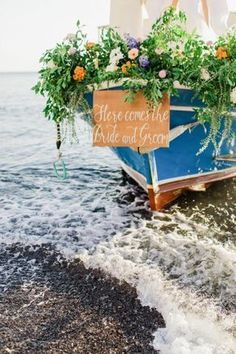 Bride and groom arrive on a decorated with flowers boat Wedding Body, Boat Wedding, Coastal Wedding Centerpieces, Santorini Beaches, Coastal Wedding Inspiration, Beach Ceremony, Corsage Wedding, Greece Wedding, Bridezilla