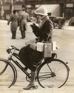 """""""Shopping Made Easy"""" Miss Marsh a south coast resident has devised this novel method of carrying home the parcels when out shopping on her bicycle, by the aid of hooks attached to her back. ~ ~ ~I'm guessing that this is from the 1920s?"""