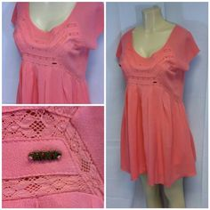 """ROXY Coral Pink Lace Sheer Dress size M ROXY Coral Pink Lace Sheer Dress size M, chest area sheet, fully lined at bust area, lace details on chest, gathered under slanted empire waist in front, drop waist in back, keyhole back button closure,  pockets in front, ROXY metal logo under left bust, skirt fully lined,  machine washable,  body 100%rayon,  lining 100% cotton, 33"""" length shoulder to hem, 18"""" bust laying flat, 18"""" waist laying flat Roxy Dresses"""