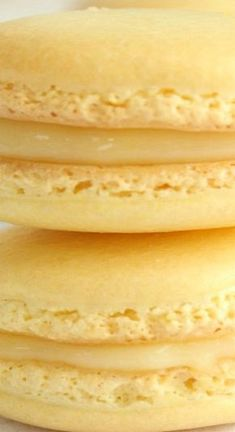 Lemon Macarons with Lemon Curd Filling - Family Table Treasures - lemoncheescake Desserts Menu, Light Desserts, Lemon Desserts, Lemon Recipes, Cookie Desserts, Just Desserts, Baking Recipes, Sweet Recipes, Cookie Recipes