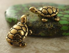2 Too Cute Turtle Charms - Antique Gold - Made in the USA - 15mm X 11mm. $4.00, via Etsy.