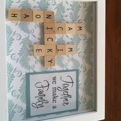 Scrabble tiles used to make family name wall art framed in shadow box