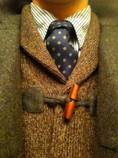 Classic British layering - Tailored tweed, shawl-collar cardigan with toggle, vertical striped shirt, dotted navy tie...perfect mixing.