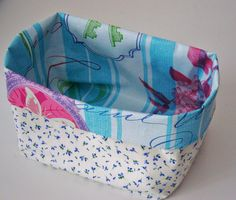 Fabric basket for all kinds of little things. Lining with wax cloth.