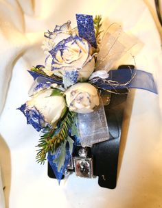 Prom/formal corsage. White roses, royal blue glitter