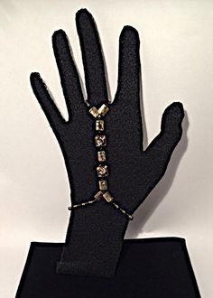 A personal favorite from my Etsy shop https://www.etsy.com/listing/268082102/gold-silver-slave-bracelet-and-ring