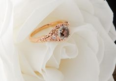 Whitehouse Brothers Edwardian Blossom vintage engagement ring in Rose Gold.  Set with 0.75ct Cognac Diamond center.