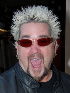 Guy Fieri...diners, dives and drive-ins.  Food network show