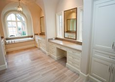 Projects | Village Cupboards Spacious master bath with double vanity and arched window above the tub