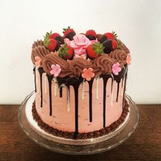 Strawberry, mint and chocolate in one cake with chocolate drips and flowers!