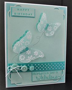 handmade card ... Papertrey Ink Birthday Card ... vellum panel with embossed butterflies rising up ... cute button trio ... monochromatic aqua ...