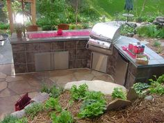 Outdoor kitchen- we like simple. covered area with fans. walkway to fire pit. have small bar area with chairs here. with few small patio tables.