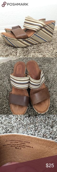 "Born stripe blue brown wedges size 8 These Born wedges are tan and blue stripe. They have a leather toe strap. They are about 3.5"" tall. 1"" platform. They do have a footmark on the leather. Please note that these are a size 8/39. They fit a size 8 the best. Born Shoes Wedges"