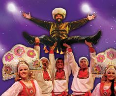 At Christmastime, singers and dancers add some holiday cheer to the Yakov Smirnoff Show in Branson.