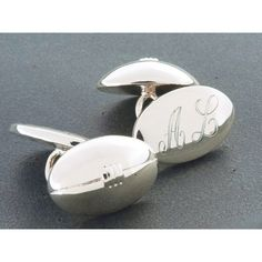 Engraved with your words to create a truly unique keepsake, these rugby ball cufflinks are the perfect present for a rugby fan.  A popular choice for wedding thank you gifts or to commemorate a special occasion, the rugby balls are attached with a chain to the oval disc on the reverse. They can be personalized with a name, date or initials. The prices shown include engraving.  The cufflinks come in a smart black presentation box with a hinged lid and white satin lining.