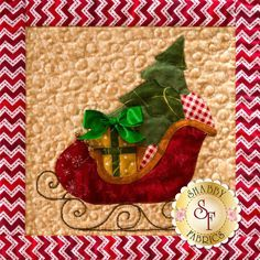 Santa's sleigh is the final block in Christmas Keepsakes from Shabby Fabrics! Sign up for this 10-month Block of the Month program here: https://www.shabbyfabrics.com/-Christmas-Keepsakes-BOM-Pre-fusedLaser-P30953.aspx