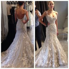 Steven Khalil. Gorgeous detailed mermaid gown with thin straps and an open back.