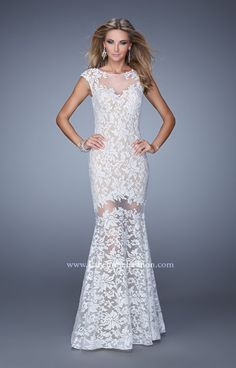 Sass up your next fabulous formal event in this stunning lace gown. La Femme 21399 features an illusion neckline with floral lace cap sleeves and an open back. The sexy cut out and fitted bodice pair nicely with the flared skirt. This dress is ideal for prom, a pageant wedding or fabulous gala. And, it has some major Beyonce inspiration from the Grammy's!