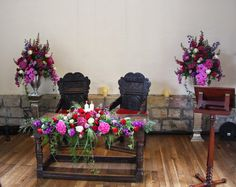 In the Whittaker Room at Samlesbury Hall the scene was set with two magnificent pedestal designs framing the Registrars Table which was dressed with a candlelit swag of Roses, Stocks and Hydrangeas in Jewel hues of passionate Purples, Magentas and Red