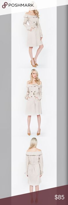 """Off Shoulder Trench Coat This off the shoulder trench coat is beyond perfect  to pair with any off the shoulder tops! This can also double up as a dress for stylish and chic vibes!   - Off the shoulder trench coat - Fold-over detail - Double-breasted front - Self belt may be tied, buckled, or removed - Long sleeves - Color: Light Taupe  Fabric -Self: 100% Cotton, Lining: 100% Polyester  Size + Fit - Model is wearing size S - Measurements taken from size S - Length: 34.5"""" Jackets & Coats…"""
