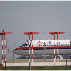 MD 80 Meridiana take off Bologna airport Italy