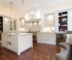 Hartford Painted Kitchen - Bespoke Kitchens � Tom Howley. Dark wood floor, light units, old fashioned taps. Great lighting!