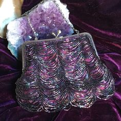 Purple Beaded Bag This little evening bag is ready to go to the Party.  Iridescent  amazing shimmers catch fire in the night.  The bead design shakes, rattle and roll.  There are spaces between beads to get more sparkle effects. This would look wonderful on your vanity. Kiss lock Bags