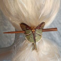 Lunamoth hair slide with stained wood chopstick.  Carved from leather and painted with acrylics.