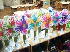 Mother's Day Flowers!  glue gun. Directions: children select paint colors for their flower. assist them in child making 6 handprints in a circle shape on paper. child paints one paper towel tube green for the stem. Attach pic of child to center of flower. TEACHER hot glues flower to tube & tube to bowl. Attach poem of your choice & ta da!
