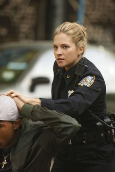Vanessa Ray as Eddie Janko in Blue Bloods. Blue Bloods Eddie, Vanessa Ray Blue Bloods, Blue Bloods Tv Show, Police Officer Uniform, Female Police Officers, Tom Selleck Blue Bloods, Detective Aesthetic, Female Cop, Military Women