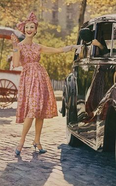 January Vogue 1959 Wearing a high waisted silk surah dress the colour of wood roses and old gold, by Greta Plattry. Photographed by Jerry Schatzberg.
