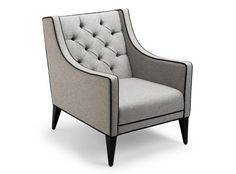 One of Stuart Scott's most coveted armchairs, the Sartor is handmade and individually numbered for no-two-the-same charm. Its solid beech frame has been beautifully upholstered in Colefax & Fowler grey wool, with contrasting piping and buttons in Manuel Canovas black lambswool. Try placing in the bedroom for a smart yet sumptuous look. #LuxDeco #Design #Homeware