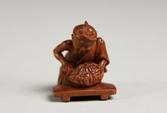 Netsuke of Man Cutting Pumpkin, late 19th century. Japan. The Metropolitan…